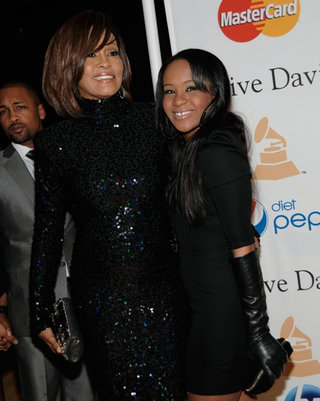 Whitney Houston and daughter Bobbi Kristina Brown arrive at the Pre-Grammy Gala and Salute to Industry Icons with Clive Davis honoring David Geffen on Saturday, Feb. 12, 2011 in Beverly Hills, Calif. (AP / Dan Steinberg)