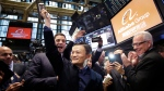 Jack Ma, center, founder of Alibaba, raises a ceremonial mallet before striking a bell during the company's IPO at the New York Stock Exchange in New York,  Friday, Sept. 19, 2014 (AP / Mark Lennihan)
