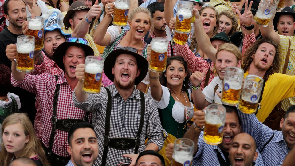 People celebrate the opening of the 181th Oktoberfest beer festival in Munich, southern Germany, Saturday, Sept. 20, 2014. (AP / Matthias Schrader)