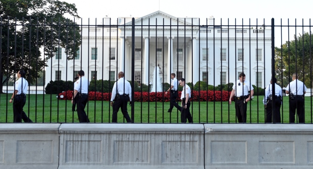 Uniformed Secret Service officers walk along the fence on the North side of the White House in Washington, Saturday, Sept. 20, 2014. (Susan Walsh/AP)