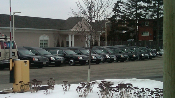 Nine hearses wait to depart a Kitchener, Ont. funeral home, Wednesday, Feb. 15, 2012.