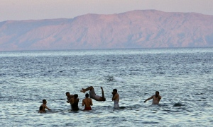 Egyptians play in the sea in the resort town of Dahab, Egypt on Wednesday, April 26, 2006. (AP / Anja Niedringhaus)