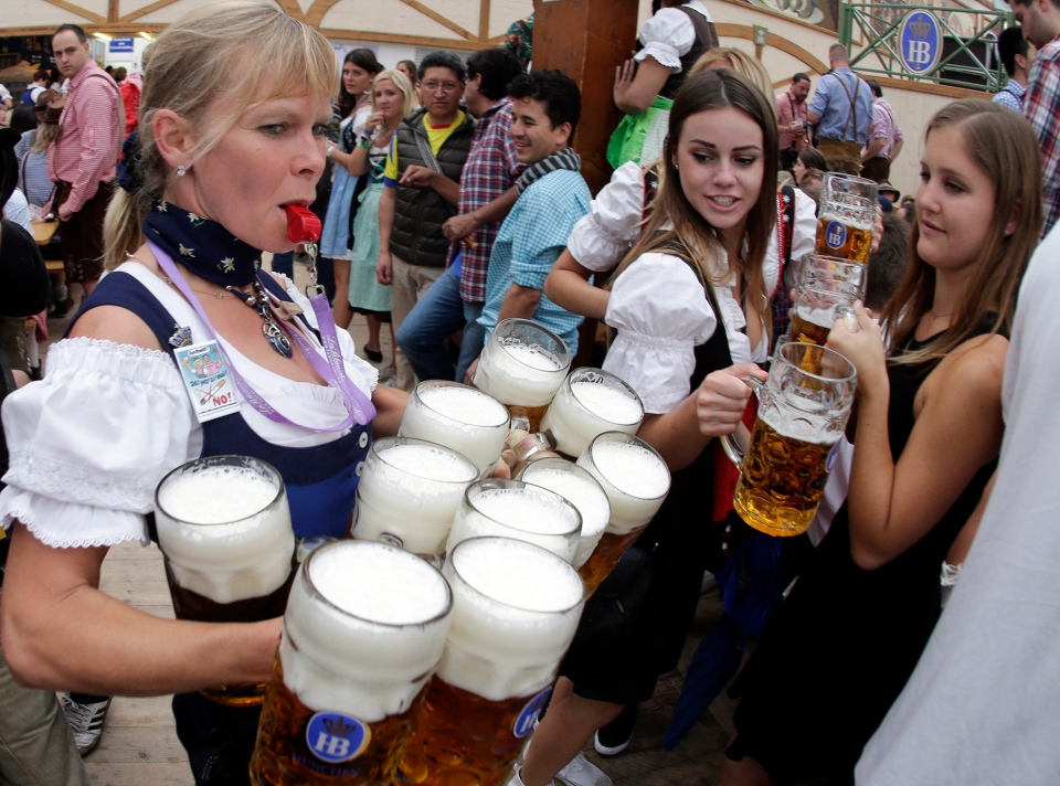 A waitress carries beer mugs during the opening of the 181st Oktoberfest beer festival in Munich, southern Germany on Saturday, Sept. 20, 2014. The world's largest beer festival will be held from Sept. 20 to Oct. 5, 2014. (AP / Matthias Schrader)