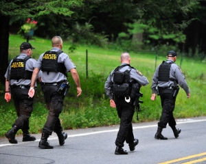 Police surround a neighborhood in the Pocono Mountains in search of suspect Eric Frein on Saturday, Sept. 20, 2014 in Canandensis, Pa. (AP / Chris Post)
