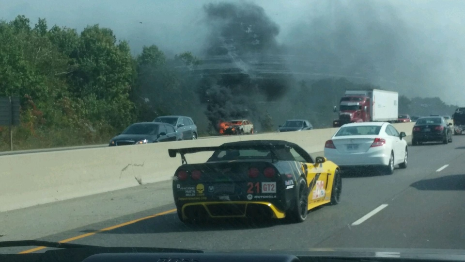 A car on fire on the shoulder of the 401 on September 20, 2014. Zoltan Zadori / MyNews