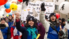 Thousands of striking daycare workers march down the streets of downtown Montreal Friday, February 10, 2012 on a one-day strike. Daycare workers have been without a contract for the past two years. THE CANADIAN PRESS/Paul Chiasson