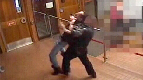 In a still captured from surveillance footage, a sheriff attempts to forcibly remove Bill Berry from the Red Deer courthouse. Wednesday February 15