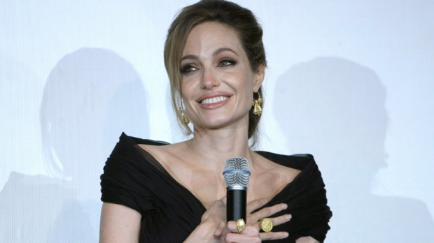 Angelina Jolie reacts as she addresses the audience after a gala premiere of her movie in Sarajevo, Bosnia on Tuesday, Feb. 14, 2012. Angelina Jolie is in Sarajevo for screening of her film 'In the Land of Blood and Honey.' (AP / Amel Emric)