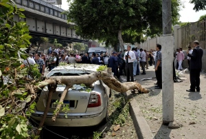 Egyptian security forces inspect the scene after a roadside bomb went off on a busy street in downtown near the foreign ministry, in Cairo, Egypt on Sunday, Sept. 21, 2014. (AP / Aly Hazzaa / El Shorouk)