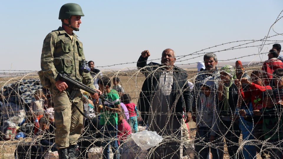 Syrian refugees at the border in Suruc, Turkey