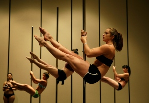 In this Sept. 7, 2014 photo, Quinn McCrimmon, front, and others take part in a workshop at the Pole Expo in Las Vegas. (AP Photo/John Locher)