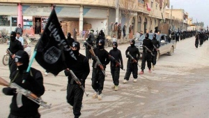 In this undated file image posted on a militant website on Tuesday, Jan. 14, 2014, which has been verified and is consistent with other AP reporting, fighters from the al Qaeda linked Islamic State group, march in Raqqa, Syria. (AP / File)