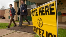 Voters head from a polling station after casting their ballot in the New Brunswick provincial election in Moncton, N.B. on Monday, Sept. 22, 2014. (THE CANADIAN PRESS / Andrew Vaughan)