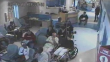 Brian Sinclair, top right in wheelchair, at WHSC
