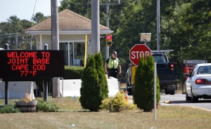 Vehicles are stopped by security personal as they enter a gate to Camp Edwards, Mass., on Monday, Sept. 22, 2014. (AP / Steven Senne)