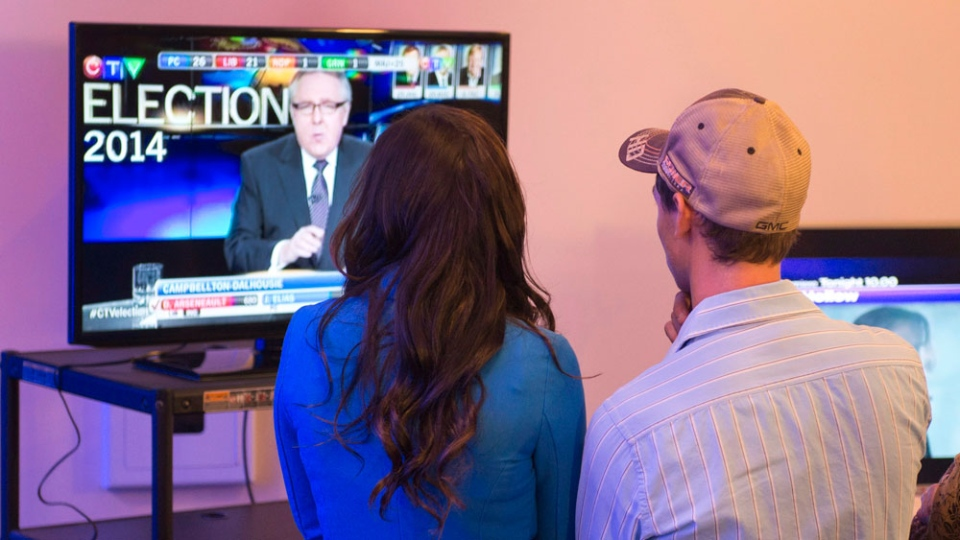 New Brunswick Tory supporters watch the election results unfold at David Alward's riding's campaign party, Monday, September 22, 2014 in Woodstock N.B. (THE CANADIAN PRESS/Jacques Boissinot)