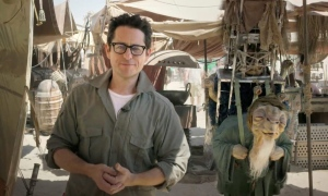 "May 22, 2014, J.J. Abrams, director of ""Star Wars: Episode VII,"" talks to the fans from the movie set in the desert in Abu Dhabi, United Arab Emirates. (AP / Lucasfilm Ltd.)"
