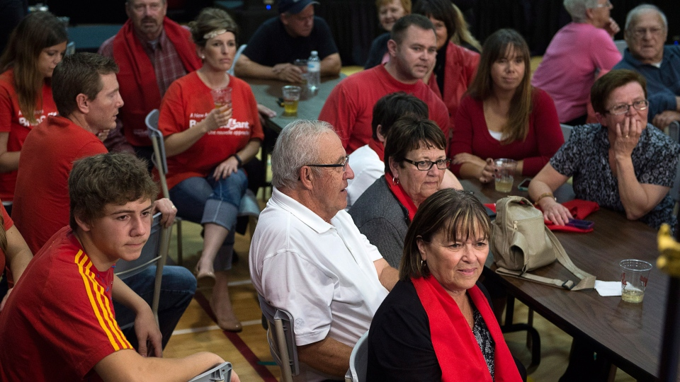 Supporters of New Brunswick Liberal Leader Brian Gallant wait for results at his election night headquarters in Grande-Digue, N.B. on Monday, Sept. 22, 2014. (Andrew Vaughan / THE CANADIAN PRESS)