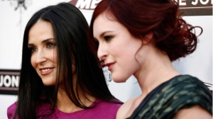 Demi Moore and Rumer Willis pose together at the premiere of 'The Joneses' in Los Angeles on Thursday, April 8, 2010. (AP / Matt Sayles)