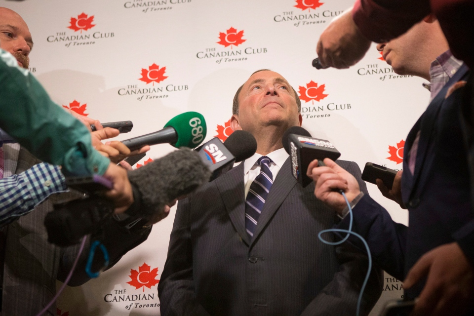 NHL Commissioner Gary Bettman scrums with journalists after discussing the launch of the upcoming season at a meeting of The Canadian Club of Toronto, in Toronto on Monday September 22, 2014. THE CANADIAN PRESS/Chris Young