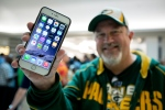 John Mihalkovic, of Virginia Beach, Va., shows off his newly purchased iPhone 6 Plus outside the Apple store at Lynnhaven Mall in Virginia Beach Sept. 19, 2014. (AP / The' N. Pham)