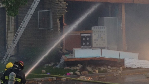 Emergency crews respond to an explosion at a residence on Apple Lane in Winnipeg on Sept. 23, 2014.