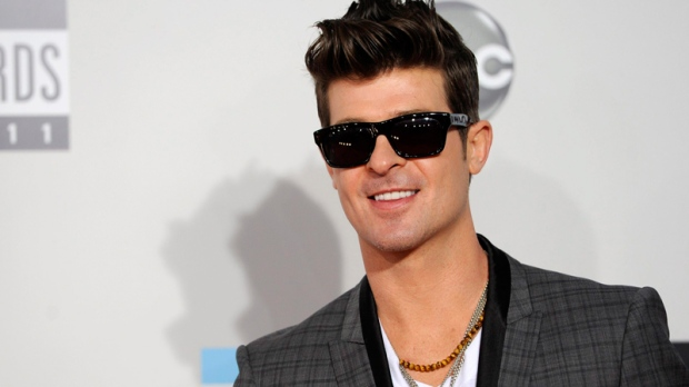 Robin Thicke arrives at the 39th Annual American Music Awards on Sunday, Nov. 20, 2011 in Los Angeles. (AP / Chris Pizzello)
