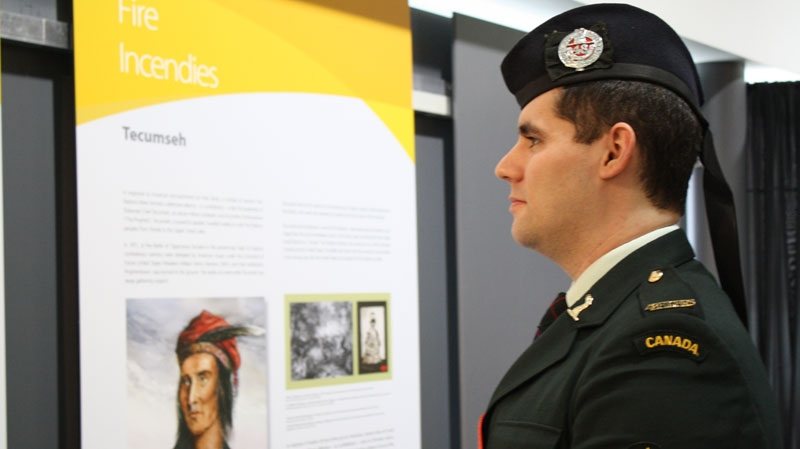 A member of the 48th Highlanders of Canada views the exhibit at the new Parliament interpretive centre in Toronto on on Friday, Feb. 17, 2012. (Miranda Scotland / CTV)