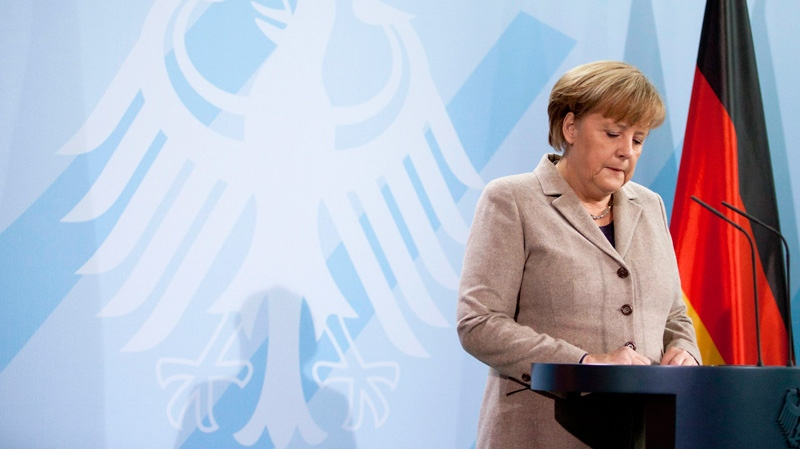 German Chancellor Angela Merkel briefs the media after President Christian Wulff stepped down in Berlin, Friday, Feb. 17, 2012. (AP / Markus Schreiber)