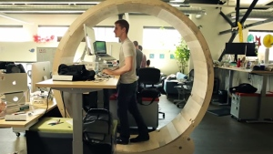 In this YouTube screengrab, the Hamster Wheel Standing Desk is pictured. (Photo from Robb Godshaw/Youtube 2014)