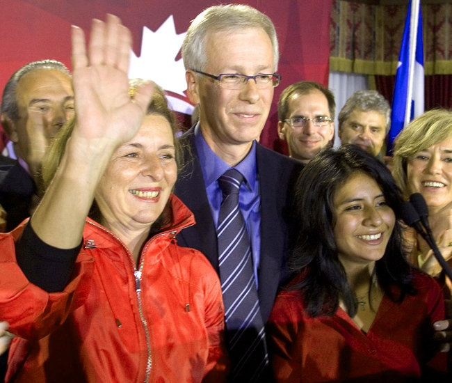 Liberal Leader Stephane Dion stands on stage with his wife Janine Krieber and daughter Jeanne Dion during a night-time rally in his riding of Saint Laurent-Cartierville in Montreal, Que. on Monday, Sept. 8, 2008. (Adrian Wyld / THE CANADIAN PRESS)