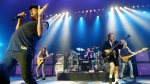 Australian rock band AC/DC is shown in this June 2003 file photo. From left: Brian Johnson, Malcolm Young, Phil Rudd, Angus Young, and Cliff Williams. (AP / Jan Pitman)