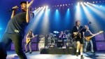 This June 17, 2003 file photo shows rock band AC/DC, from left, Brian Johnson, Malcolm Young, Phil Rudd, Angus Young, and Cliff Williams performing on stage during a concert in Munich, southern Germany. (AP Photo/Jan Pitman)