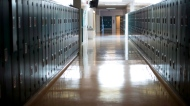 A empty hallway is seen at a school in this Sept. 5, 2014 file photo. (Jonathan Hayward / THE CANADIAN PRESS)