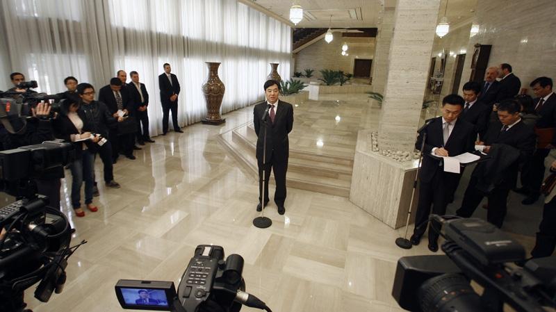 Chinese Vice Foreign Minister Zhai Jun speaks to the media in Damascus, Syria, Saturday, Feb. 18, 2012. (AP Photo/Muzaffar Salman)
