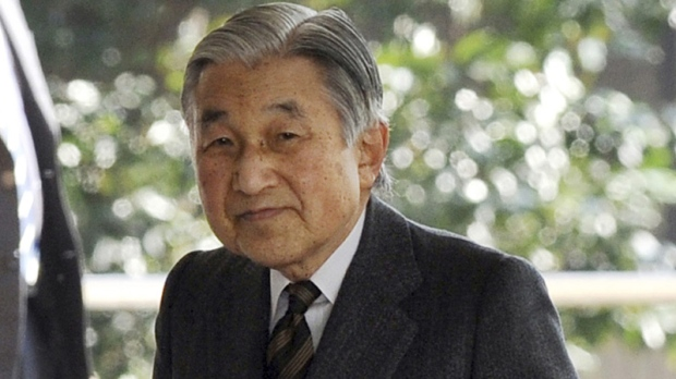 In this Feb.17, 2012 file photo, Japanese Emperor Akihito is greeted by doctors upon his arrival at the entrance of University of Tokyo Hospital in Tokyo. (AP Photo/Toshifumi Kitamura, File)