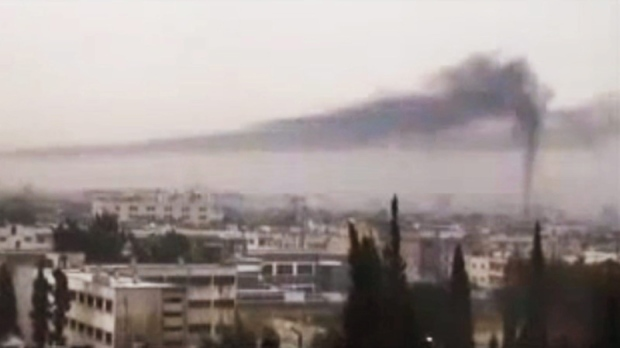 This image from amateur video made available by Shaam News Network, purports to show black smoke rising in the air in Homs, Syria, Thursday, Feb. 16, 2012.(AP Photo/Shaam News Network via APTN)