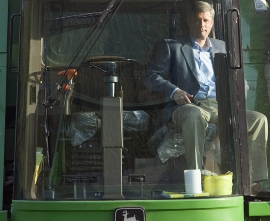 Conservative Party Leader Stephen Harper sits in a John Deere combine during a campaign stop at a local farm in Regina, Sask. on Monday, Sept. 8, 2008. (Tom Hanson / THE CANADIAN PRESS)