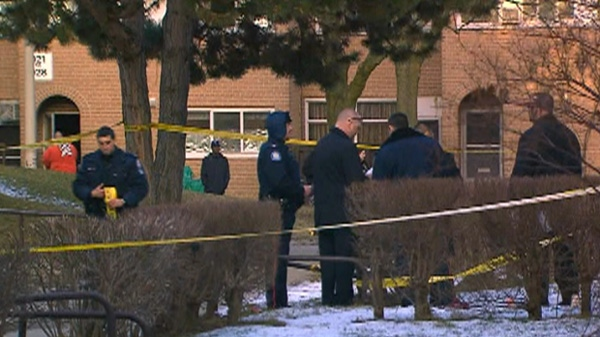 Investigators are shown at the scene of a shooting on Tandridge Crescent, Sunday, Feb. 19, 2012.
