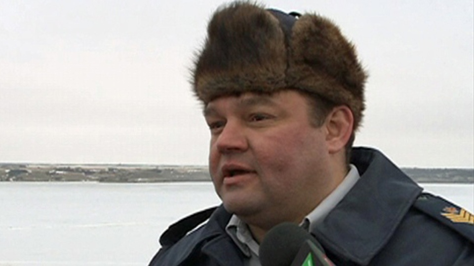 An RCMP officer is shown wearing a traditional muskrat hat in this undated file photo.