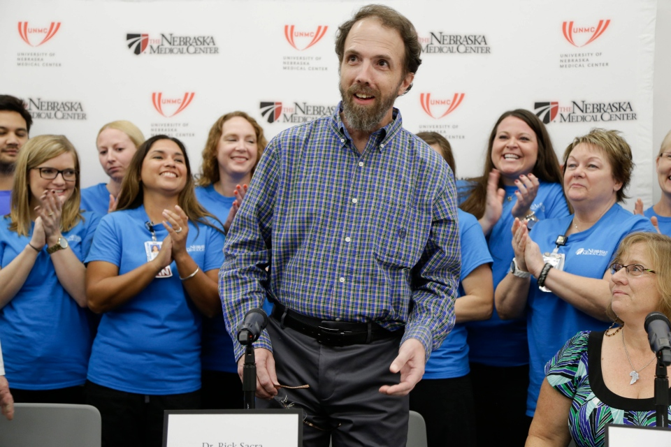Former Ebola patient Dr. Richard Sacra arrives to a news conference at the Nebraska Medical Center in Omaha, Neb., Thursday, Sept. 25, 2014.  (AP / Nati Harnik)