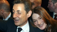 Nicolas Sarkozy, left, and his wife, Carla Bruni Sarkozy leave a meeting in Marseille, southern France, Sunday, Feb. 19, 2012. (AP / Claude Paris)