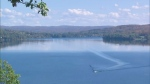A lone boat crosses a lake in Huntsville, Ont. on Thursday, Sept. 25, 2014. (Sean MacInnes / CTV Toronto)