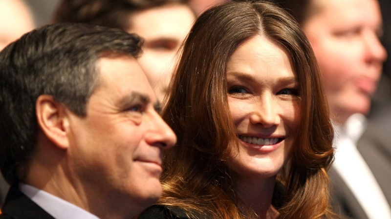Carla Bruni Sarkozy, right, speaks with First Minister Francois Fillon, at a meeting in Marseille, southern France, Sunday, Feb. 19, 2012. (AP / Claude Paris)