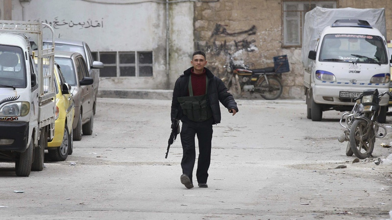 A Syrian rebel is seen after Syrian army tanks entered the northwestern city of Idlib, Syria, Wednesday, Feb. 15, 2012. (AP Photo)