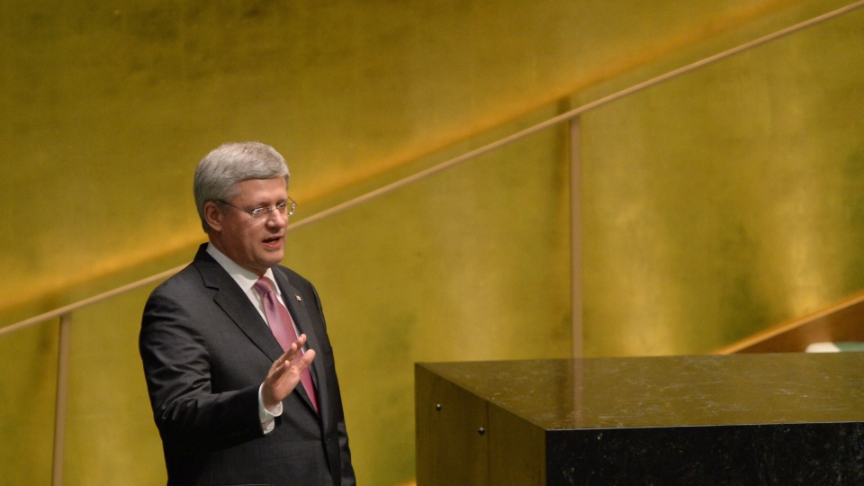 Prime Minister Stephen Harper waves after addressing the 69th session of the United Nations General Assembly at the United Nations headquarters in New York on Thursday, September 26, 2014. (Sean Kilpatrick / THE CANADIAN PRESS)
