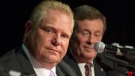 Doug Ford sits alongside John Tory during a debate in Toronto on Sept. 23, 2014. (Chris Young / THE CANADIAN PRESS)