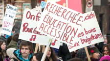 Students take part in a demonstration against higher tuition fees Monday, Feb. 20, 2012 in Montreal. (Ryan Remiorz / THE CANADIAN PRESS)