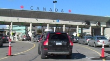 Canadian vehicles line up at a border crossing to head into the U.S., on Monday, Feb. 20, 2012.