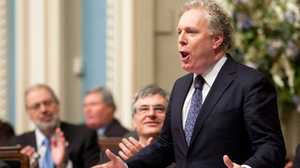 Quebec Premier Jean Charest responds to the Opposition at the legislature in Quebec City, Thursday, Feb. 16, 2012. (Jacques Boissinot / THE CANADIAN PRESS)